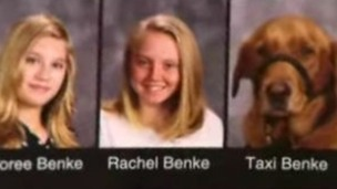 Rachel Benke pictured next to her service dog Taxi in her yearbrook photograph.