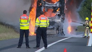 The double-decker bus was completely alight.