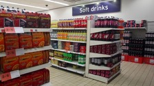 A coalition of doctors and nutritionists says there is far too much sugar in soft drinks.