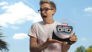 The star, who is currently touring with McBusted, shows off his award.