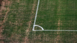 The corners o the pitch are also badly browned amid high temperatures.