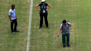 The Manaus pitch appears to be sprayed ahead of England v Italy on Saturday.