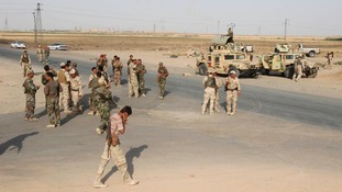 Members of Kurdish security forces take part in an intensive security deployment outside Kirkuk.