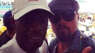 Former Fugees member Pras Michel and Leonardo Di Caprio at the game.