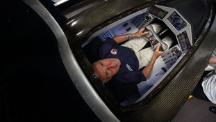 Andy Green, 51, sits in the cockpit of the £10 million vehicle.