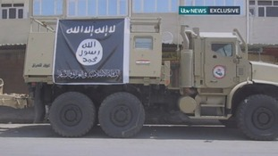 An Iraqi military vehicle with the ISIS logo attached onto it.