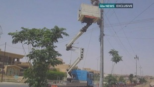 A utility worker on a cherry picker tries to restore electricity to the areas of Mosul with no power.
