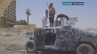 Children clamber on top of a military vehicle in central Mosul.