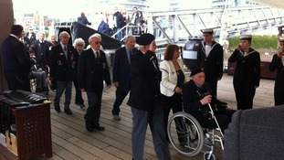 D Day Veterans arriving on ship.
