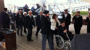 D Day Veterans arriving on ship.