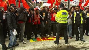Demonstrators stamping on the Sri Lankan flag.