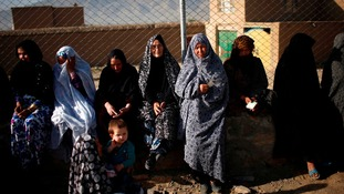 Afghan women wait in line to cast their votes at a polling station in Kabul today.