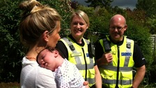 Sophia Clay introduces her baby to the police officers who helped bring her into the world