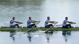 Four rowers in a boat.