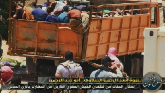 Picture appearing to show ISIS militants loading captives into a truck.