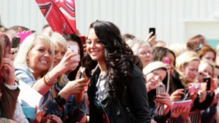 Tulisa Contostavlos wore a floral mini-dress as she took the red carpet and greeted fans who gathered outside.