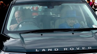 The Duke of Edinburgh and Queen Elizabeth II arrive for the Cartier Queen's Cup.
