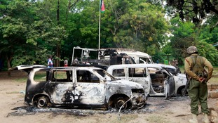 Torched vehicles outside the Mpeketoni police station.