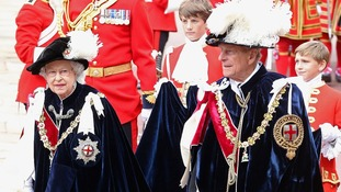 The Queen and Duke of Edinburgh at Windsor today, wearing their Garter mantles and hats.