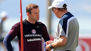 Wayne Rooney with Roy Hodgson in training.