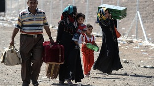 An Iraqi family flees the fighting in Mosul.