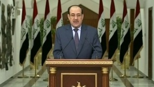 Iraqi Prime Minister Nouri Al-Maliki addressing  the nation on television.