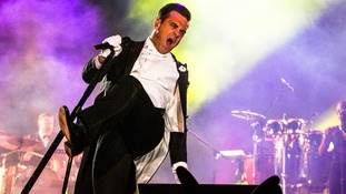 Robbie Williams, who is renowned for his energetic performances, had to scale back on his football due to the back pain.