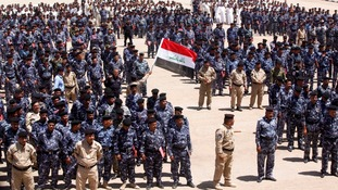 Volunteers who have joined the Iraqi security forces gather in the holy city of Najaf.