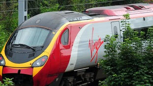 A temporary deal allows Virgin to run the West Coast service until November.