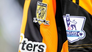 The Tigers old badge featured writing