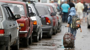 Cars queuing to leave Ukraine at a border post in Izvaryne, along the Ukraine-Russia border today