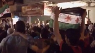 Amateur video has emerged from Syria purportedly showing protesters on the streets following the reported massacre.