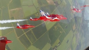 A view from inside the cockpit of a Red Arrows jet.