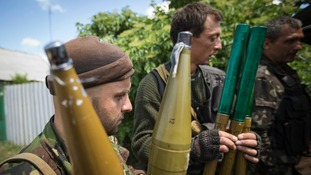 People said to be pro-Russian separatists hold rocket-propelled grenades.