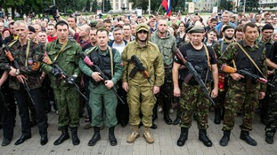 Armed pro-Russian separatists pledge an oath during a ceremony in the city of Donetsk today.