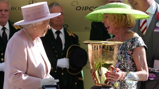 Queen Elizabeth II presents to the winning owner of Slade Power ridden by Wayne Lordan after winning the Diamond Jubilee Stakes.