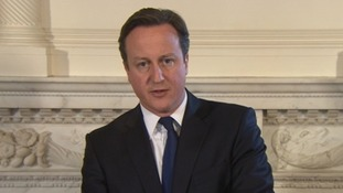 David Cameron making a statement about the men's deaths.