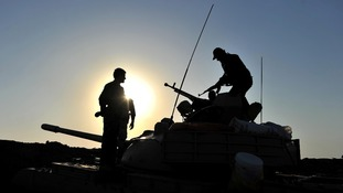 Kurdish Peshmerga forces stand guard in the oil-rich northern city of Kirkuk.