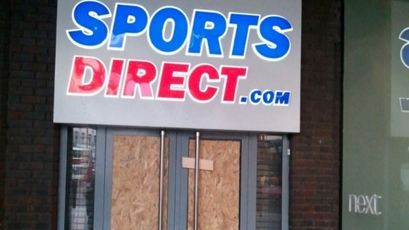 Damage caused by Newcastle Fans who vandalised doors and windows of Sports Direct stores in Newcastle