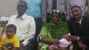 Meriam Ibrahim, centre, with her husband, left, and new-born baby by her side.