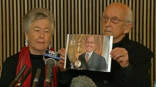 Peter Greste's parents held his picture aloft as they maintained his innocence.