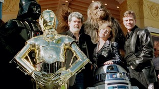 Star Wars creator George Lucas with Carrie Fisher, Mark Hamill and some of the series' most famed characters.
