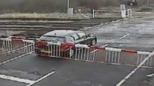 Car trapped within barriers