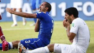 Luis Suarez appeared to bite Italy's Georgio Chiellini on Tuesday.