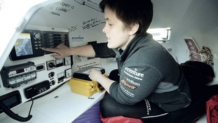 Sarah Outen examining the Japan to Canada route on her boat