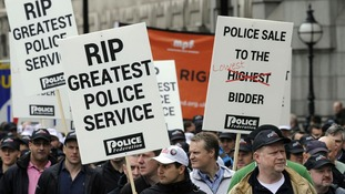 Police Federation members march during a protest against wide-ranging changes to their pay and pensions, at Millbank, London in May 2012