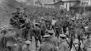 British soldiers from the Royal Welch Fusiliers and the Cheshire Regiment in a Belgian town on their way to Mons in 1914.