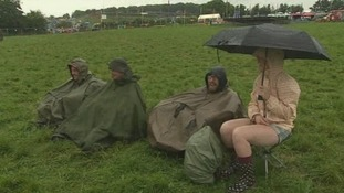 Music-lovers embrace the wet weather ahead of tonight's performances.