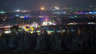 A general view at night-time of the Glastonbury Festival.