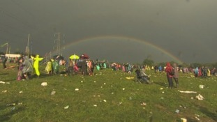 A huge rainbow appeared in the grey skies at Glastonbury following a storm that cut Rudimental's set.
